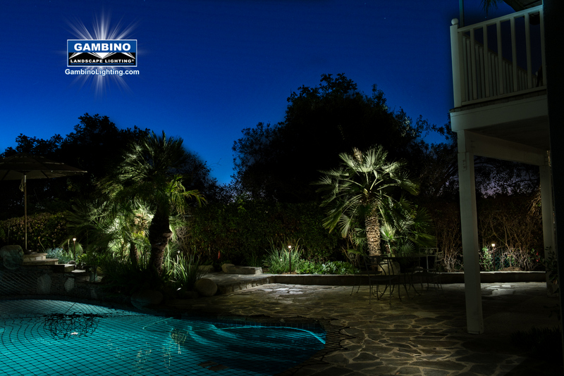 Soft lighting is added in the foreground on the pool deck and between the accent lighted palm trees making the scene more attractive and aesthetically pleasing to the viewer